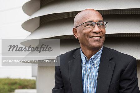 Portrait African businessman smiling happy