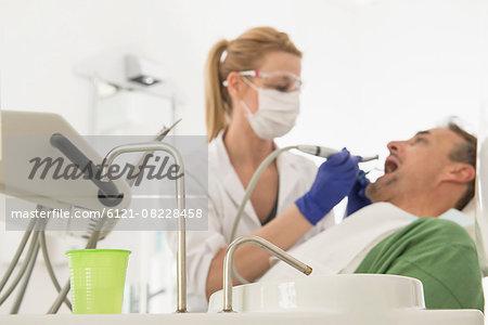Female dentist examining patient, Munich, Bavaria, Germany