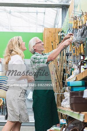 Customer buying gardening equipment from garden centre, Augsburg, Bavaria, Germany
