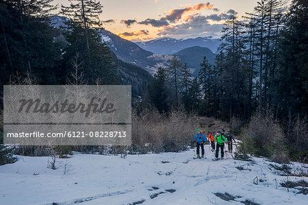 Ski mountaineers climbing on mountain, Val Gardena, Trentino-Alto Adige, Italy