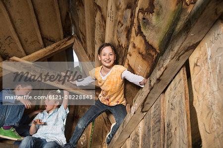 Three children playing in a playground, Munich, Bavaria, Germany