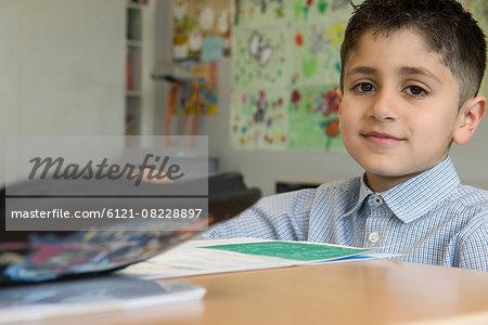 Portrait of a school boy taking exam in classroom, Munich, Bavaria, Germany