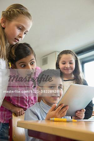 School children using a digital tablet in a classroom, Munich, Bavaria, Germany,