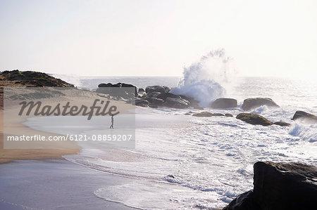 Woman walking on the beach, Western Province, Sri Lanka