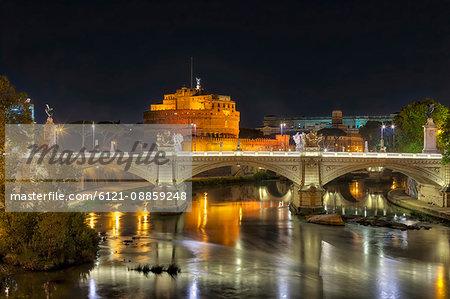 Bridge and Ponte SantAngelo illuminated at night, Rome, Italy