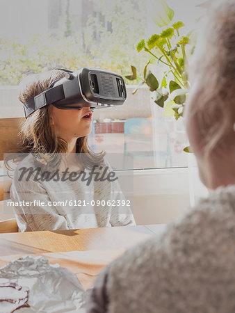 Girl wearing virtual reality glasses