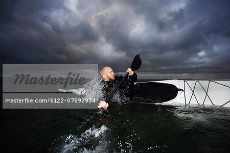 Man in kayak rotating