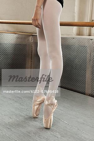 Legs and feet of ballerina en pointe
