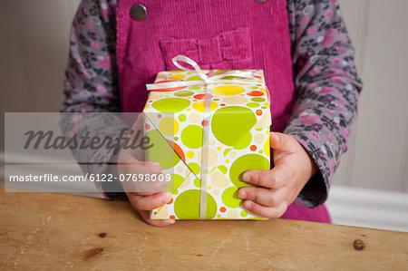 Little girl holding a gift