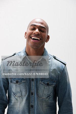 African American man smiling, studio shot