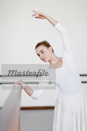 Ballet dancer posing at barre