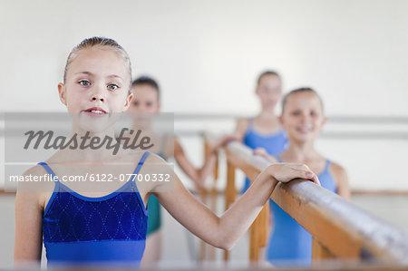 Ballet dancers standing at barre