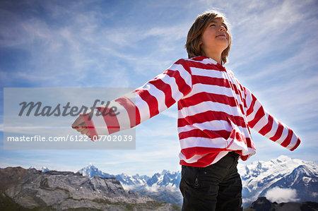 Boy standing in rocky landscape