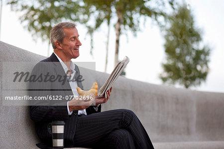 Businessman having breakfast outdoors