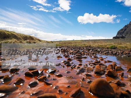 Rocks in rural pond