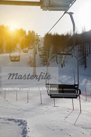Ski chairlift over snowy landscape