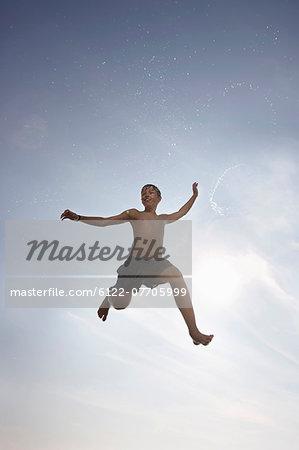 Boy posing in mid-air