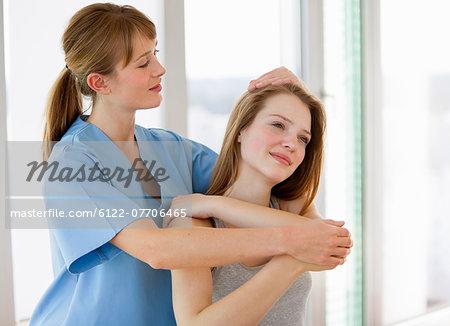 Doctor examining girl in office