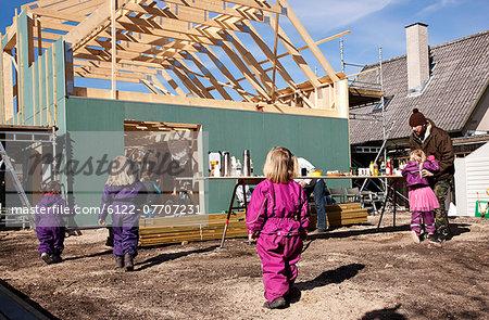 Children walking on construction site