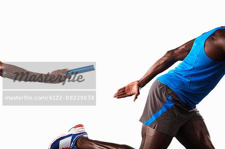 Athlete passing relay baton