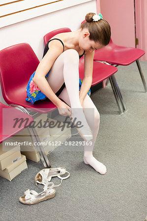 Ballet student tying slippers