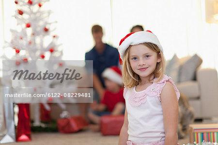 Smiling girl wearing Santa Claus hat