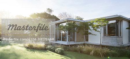 Sunny yard and modern house