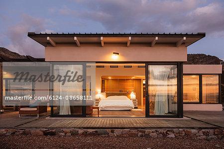 Illuminated home showcase bedroom with open patio doors
