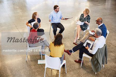 Business people talking in circle meeting