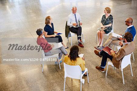 Business people talking in meeting circle