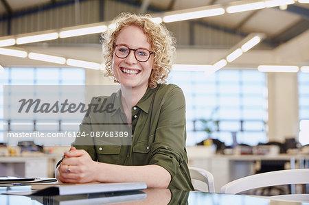 Portrait smiling businesswoman in office