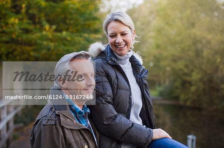 Happy mature couple in autumn park