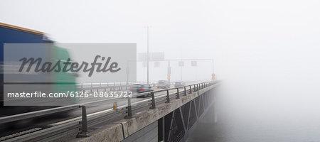 Sweden, Skane, Malmo, Oresund Bridge covered in mist