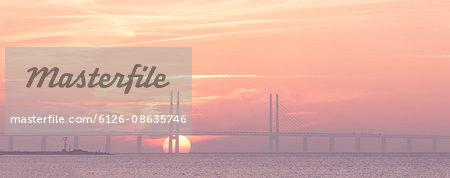 Sweden, Skane, Malmo, Oresundsbron, View of bridge during sunset