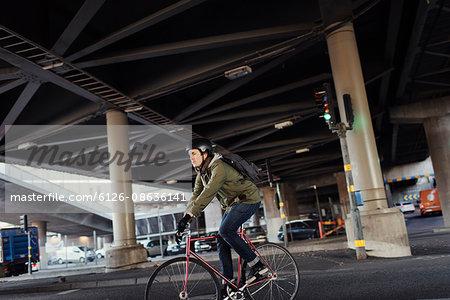 Sweden, Sodermanland, Stockholm, Sodermalm, Slussen, Mid adult man cycling in city