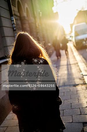 Sweden, Stockholm, Sodermalm, Rear view of walking woman