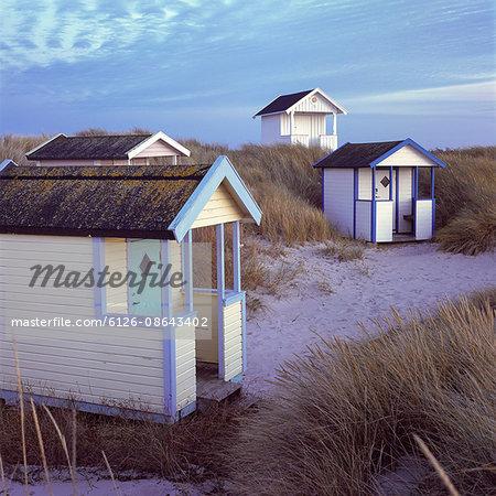 Sweden, Skane, Skanor Falsterbo, Beach huts in autumn evening