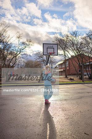 Sweden, Vastergotland, Lerum, Girl (10-11) playing basketball