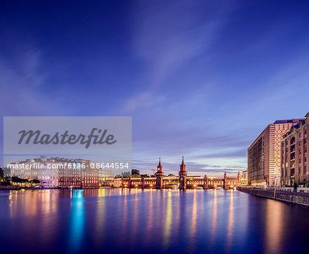 Germany, Berlin, Illuminated waterfront skyline with Oberbaum Bridge
