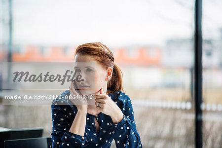 Finland, Helsinki, Portrait of red haired woman