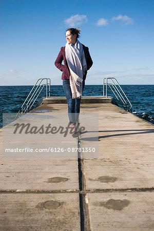Sweden, Skane, Malmo, Woman standing on pier