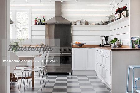 Domestic kitchen with white furniture