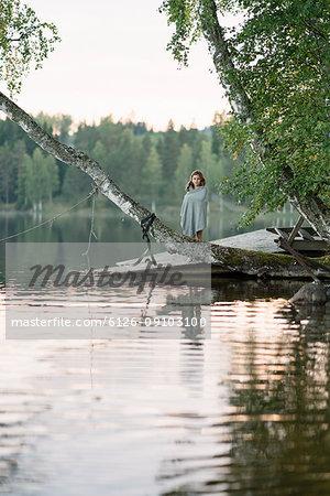 Girl standing on lakeshore