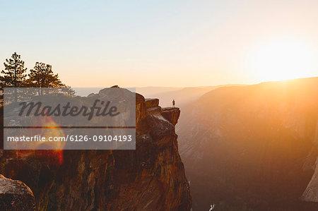 Man standing at edge of rock in Yosemite National Park