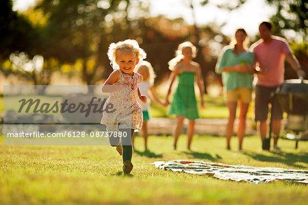 Happy siblings playing in their backyard.
