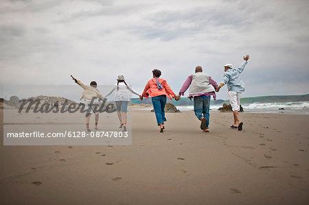 Family having fun at beach.