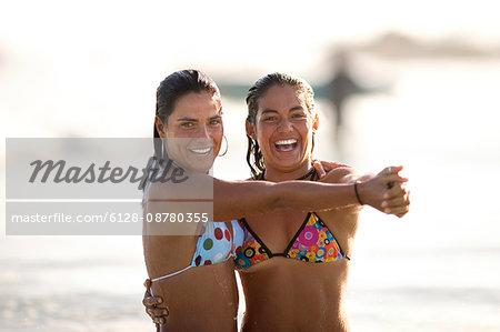 Two girls dancing on beach