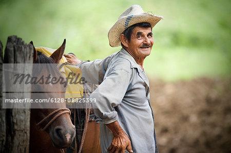 View of a senior man near a horse.