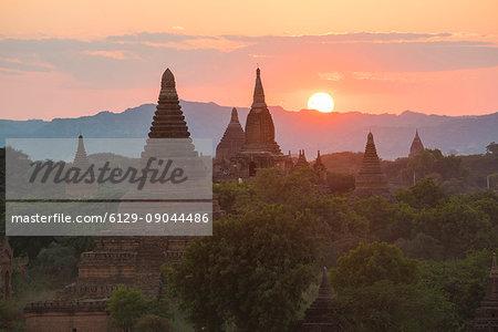 Bagan, Mandalay region, Myanmar (Burma). Stupas at sunset.