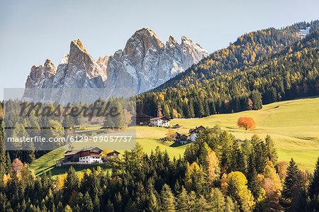 Autumnal landscape with Odle Dolomites peaks on the background. Santa Maddalena, Val di Funes, Trentino Alto Adige - Sudtirol, Italy, Europe.